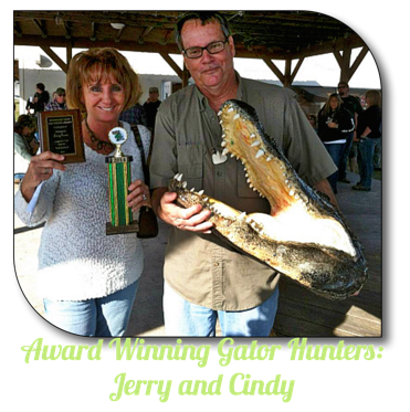 Cindy and Jerry holding a trophy for largest gator of 2014.